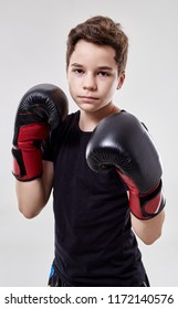 Young boy muay thai fighter in various postures