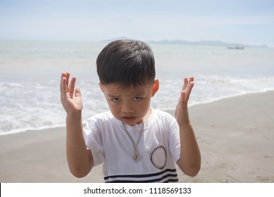Young boy on the beach with recreation acting