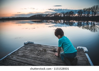 Young boy on the dock in Minnesota