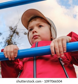 Young boy on metal playstructure, child activity recreation