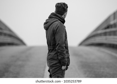young boy on the road - black and white photo