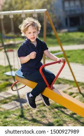 Young boy on teeter at playground