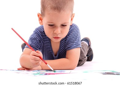 young boy painting over white