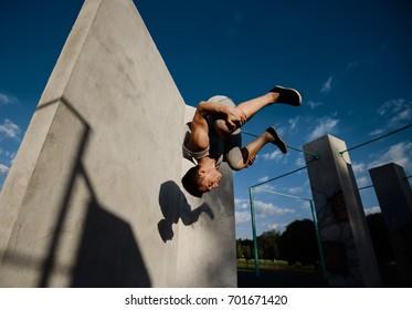 Young boy parkour a jump