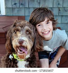 Young boy with Pet Dog closeup