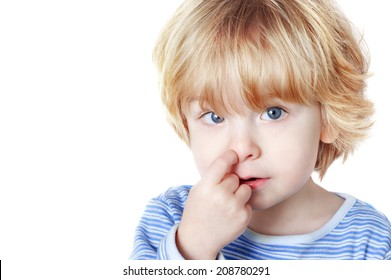 Young boy picking his nose