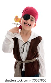 A young boy pirate holds a pet love bird on perched on a wooden stand
