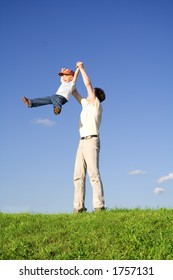 Young boy play with father