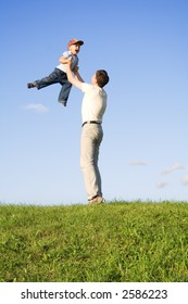 Young boy play with father. Green grass. Blue sky. 5