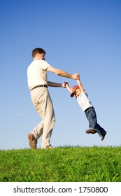 Young boy play with father - motion blur