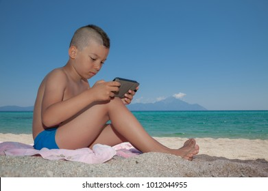 Young boy Play Smartphone Beach