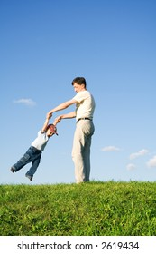 Young boy played with father. Green grass. Blue sky. 7