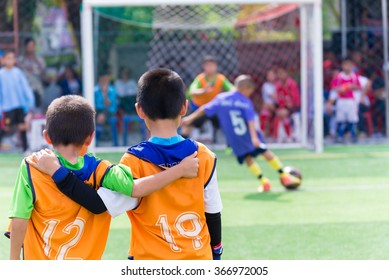 Young boy player waiting for kick a ball, football soccer match for children