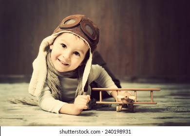 Young boy, playing with airplane, indoor