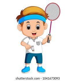 Young boy playing badminton