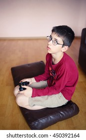 Young boy playing a computer games