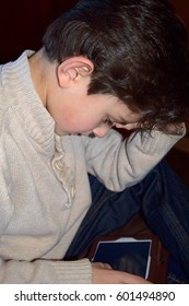 Young boy playing with electronic device