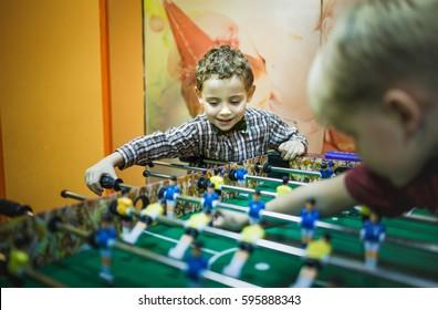 Young boy playing foosball