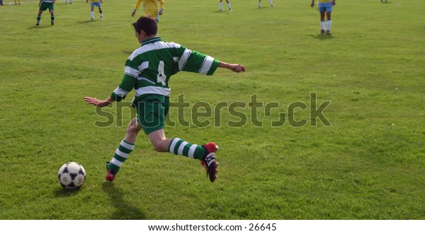 young boy playing football,soccer
