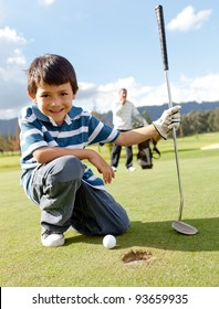 Young boy playing golf at the club