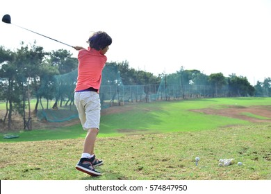 Young boy playing golf golf for kids lessons