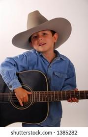 Young boy playing guitar