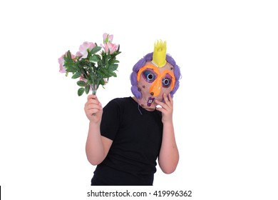 Young boy playing with handmade paper mask on a white background