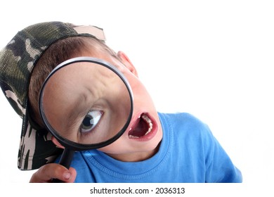 Young boy playing with a magnifying glass