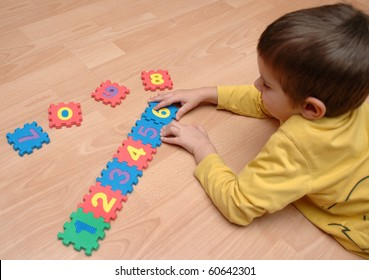 young boy playing with numbers