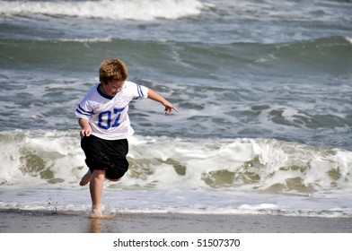 A young boy playing on the beach