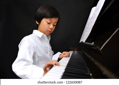 Asian pianist young boy confirm. was
