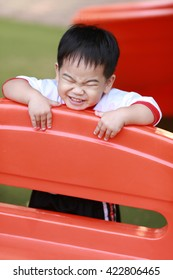 young boy playing in playground
