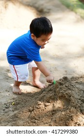 Young boy is playing with sand box on playground