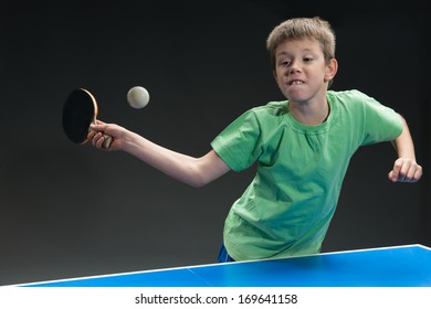 young boy playing table tennis