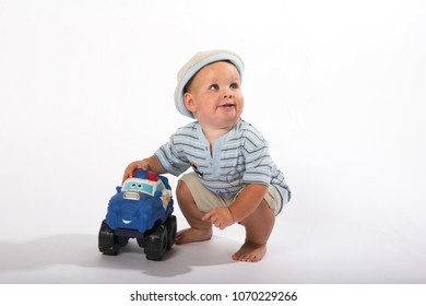 Young boy playing with toy car, insolated