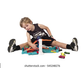 Young boy playing with toys on a white background