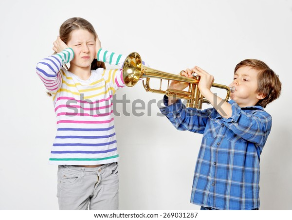 Young Boy Playing Trumpet His Sister Stock Photo (Edit Now