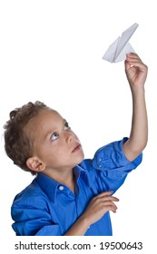Young boy plays with paper plane