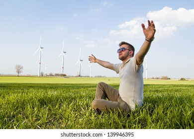 Young boy posing in field