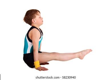 young boy posing gymnastic in studio