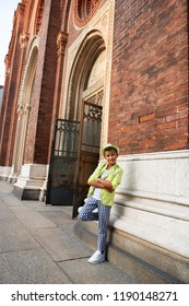Young boy posing in the milanese streets. Cute happy 6 years old boy posing in Milan, Italy. Kid's outdoor portrait, kid's street fashion. Trendy boy in suit walking in the Italian capital of fashion.