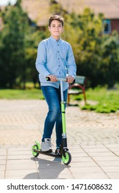 Young boy posing on scooter