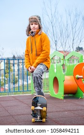Young boy practicing skating in the park on soft surface for preventing injuries