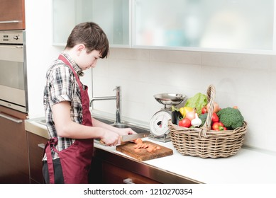young boy prepare vegetables over the bench in the kitchen