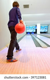 Young boy prepared on bowling lane