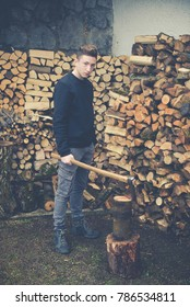 young boy prepares firewood - vintage style photo