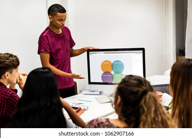 Young boy presenting a project to the team