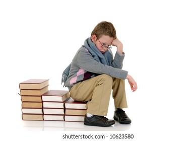 Young boy, prodigy next to encyclopedia books. white background.
