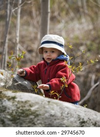 young boy pround to reach the top in nature