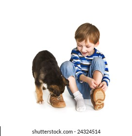 Young boy and puppy